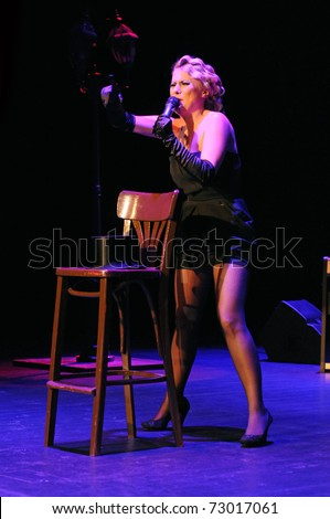 SIEDLCE, POLAND - MARCH 12, Marlena Uzieblo performs on stage on a tribute to Marlene Dietrich at CKiS Theatre on March 12, 2011 in Siedlce, Poland