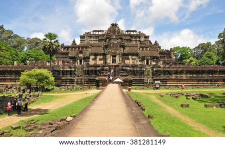 SIEM REAP, CAMBODIA - AUGUST 10: Tourists visit at Baphuon temple on August 10, 2014 in Siem Reap, Cambodia. The Baphuon is a temple at Angkor Thom. Built in the mid-11th century.