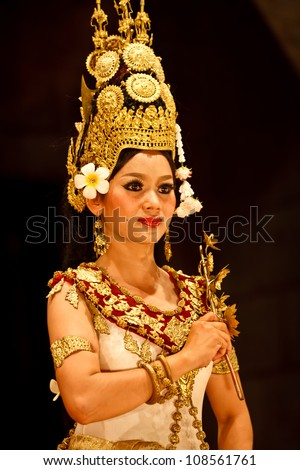 SIEM REAP, CAMBODIA - DECEMBER 28, 2008: Close-up of Khmer classical dancer in full traditional costume December 28, 2008 in Siem Reap, Cambodia.Angkor Wat is the most visited place in Cambodia. - stock photo