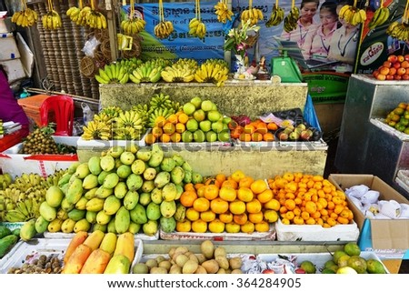 SIEM REAP, CAMBODIA -10 DECEMBER 2015- Colorful tropical fruit for sale at an open air street market in Siem Reap, Cambodia.
