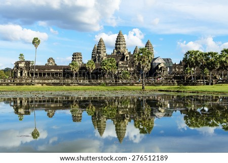 SIEM REAP, CAMBODIA - DECEMBER 5: Tourist visited Angkor Wat on December 5, 2014. It is a temple complex in Cambodia and the largest religious monument in the world. - stock photo