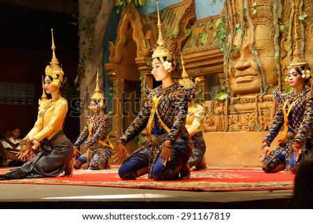 SIEM REAP, CAMBODIA - FEB 14, 2015 - Apsara dancers kneel at the end of a performance, Siem Reap,  Cambodia