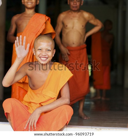 SIEM REAP, CAMBODIA - JAN 25: Unidentified Buddhist monk at Wat Chowk in Siem Reap on January 25, 2012. Buddhism is currently estimated to be the faith of 96% of the Cambodian population. - stock photo