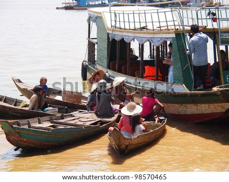 SIEM REAP, CAMBODIA-Mar 20: Cambodian people live  on Tonle Sap Lake in Siem Reap, Cambodia on March 20, 2012. Tonle Sap is the largest freshwater lake in SE Asia peaking at 16k km2