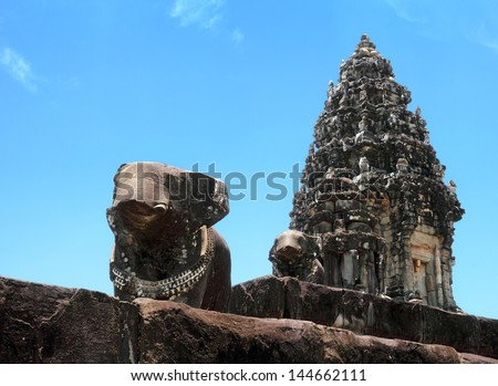 SIEM REAP/CAMBODIA - MAY 03. Beautiful view of stone elephant and hindu tower on may 03, 2013 in Bakong temple, Cambodia. It is one of the most ancient building in Angkor archaeological complex - stock photo