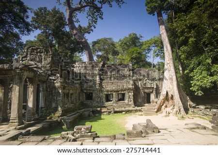 SIEM REAP, CAMBODIA - NOV 17: The famous Angkor Wat on November 17, 2014 near Siem Reap, Cambodia. The temple was hidden for many years and covered by the rain forest.