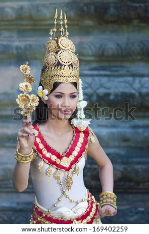 SIEM REAP,CAMBODIA- NOV 25, 2011: unidentified Khmer woman classical dancer in traditional costume at Angkor Wat November 25,2011, Siem Reap, Cambodia.  - stock photo