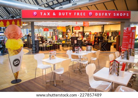 SIEM REAP, CAMBODIA - SEP 29, 2014: Duty free zone in the Siemreap International Airport. It is the busiest airport in Cambodia in terms of passenger traffic. - stock photo