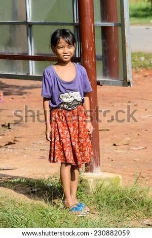 SIEM RIEP, CAMBODIA - SEP 28, 2014: Unidentified Khmer little girl walks in a traditional clothes in Siem Reap. 90% of Cambodian people belong to Khmer etnic group
