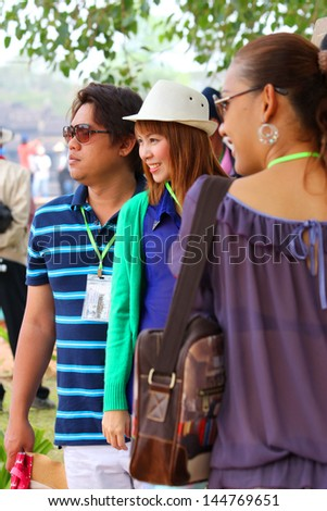 SIEMREAP, KHMER REPUBLIC - FEBRUARY 24 : Unidentified tourists are visiting to classical Khmer construction on February 24, 2013 in Angkor Wat, Siemreap, Khmer Republic.