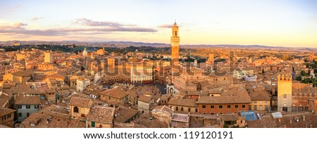 Siena aerial sunset panoramic skyline. Mangia tower and Campo square landmark. Tuscany, Italy. - stock photo
