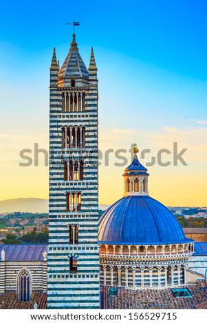 Siena aerial sunset view. Cathedral Duomo and Campanile tower landmark. Tuscany, Italy. - stock photo