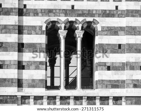 Siena, Italian medieval town - detail of a window of the cathedral steeple in black and white - stock photo
