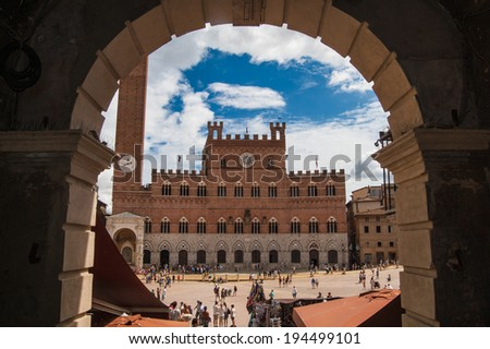 SIENA , ITALY - AUGUST 20: Piazza del Campo is the principal public space of the historic center of Siena, on August 20, 2013 in Siena, Italy