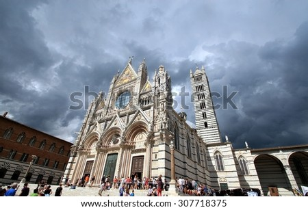 SIENA, ITALY - AUGUST 18, 2015: stormy weather day in Piazza Del Duomo, famous and Unesco World Heritage monument, symbol of Tuscany and Siena, with millions of tourists visiting it every year