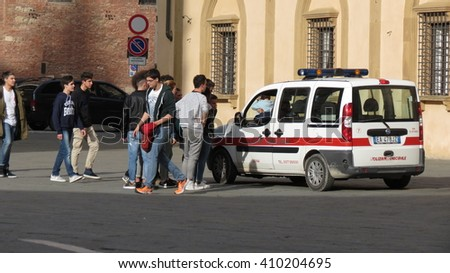 SIENA, ITALY - CIRCA APRIL 2016: Polizia muncipale (i.e. Town Police) seizing football ball of Italian schoolboys playing in the Cathedral square