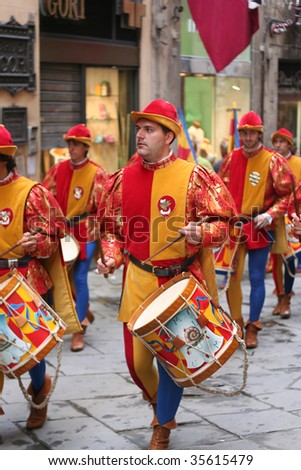 SIENA, ITALY - JULY 2: Musicians parade during the contrada of Chioccola parade through the streets of Siena July 2, 2009 in Siena, Italy. - stock photo