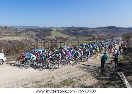 SIENA, ITALY - MARCH 03: Group of Cyclists during the 2012 Edition of Strade Bianche, bicycle race across tuscan hills, in March 03, 2012 in Siena, Italy - stock photo