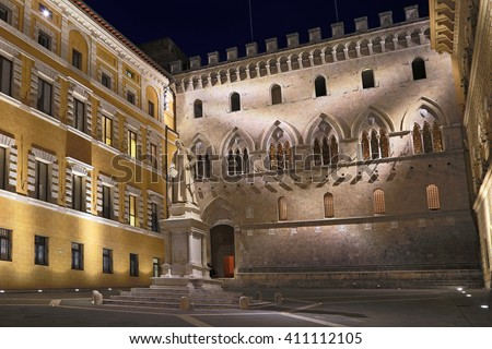 SIENA, ITALY - MARCH 11, 2016: Sallustio Bandini on Piazza Salimbeni at night, Siena, Tuscany - Italy.