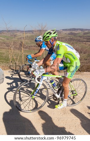 SIENA, ITALY - MARCH 03: Valerio Agnoli and another cyclist during the 2012 Edition of Strade Bianche, bicycle race across tuscan hills, in March 03, 2012 in Siena, Italy - stock photo