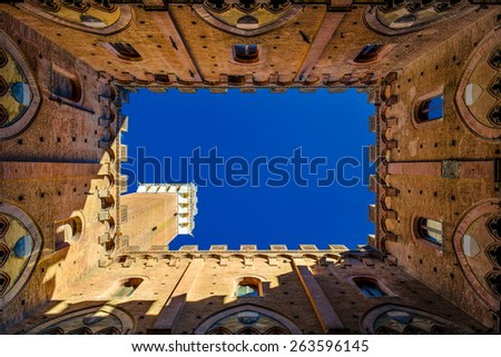 Siena's municipal palace from bottom in a sunny day - stock photo