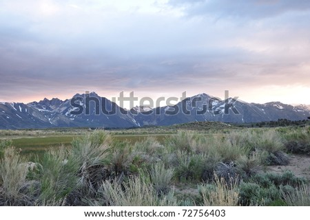 Sierra mountain range at dusk - stock photo