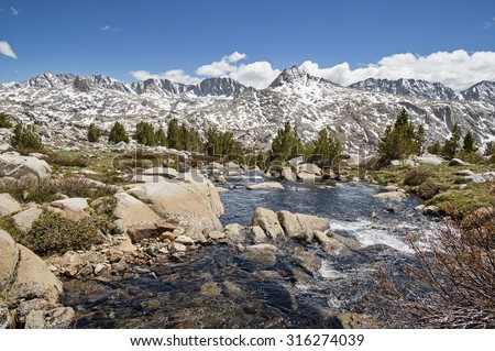 Sierra Nevada Landscape with Glacier Divide viewed from Humphreys Basin with stream in foreground - stock photo