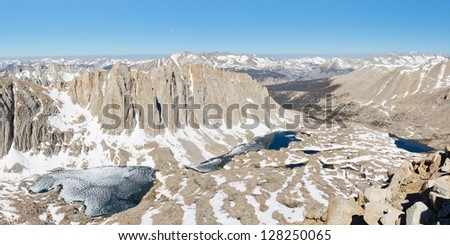 Sierra Nevada Scenery - Symbiosis of Granite, Snow and Water. Grand View from Mount Whitney. - stock photo