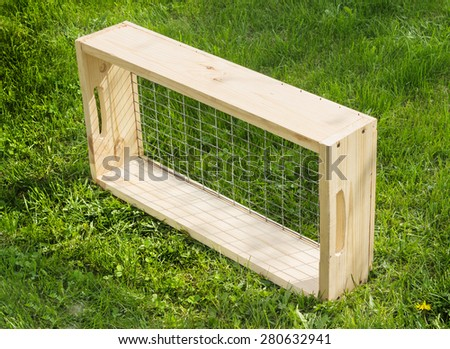 Sieve with a wooden frame for garden works - stock photo