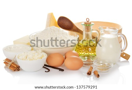 Sieve, wooden spoon and set of ingredients for the baking, isolated on white