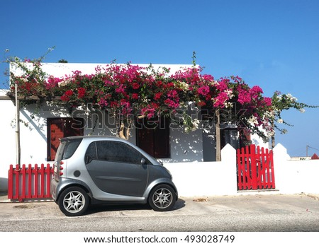 SIFNOS, GREECE-SEPT. 15: Typical Greek Island style architecture is seen in house with bougainvillea flowers in Appollonia, Cyclades, Greece on Sifnos on September 15, 2016.