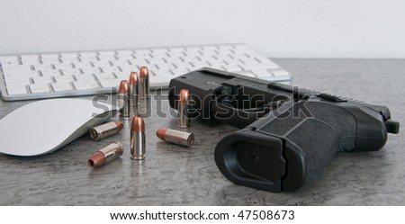 SIG PRO pistol with bullets on the table near mouse and keyboard