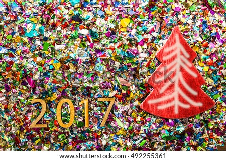Sigh symbol Christmas Tree from a lot colorful confetti, lace on old retro vintage style wooden texture background. Empty copy space for inscription. Idea of merry new year 2017 holiday