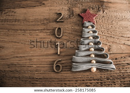 Sigh symbol from many dry Stick Christmas green Tree a lot colorful star toys on old retro vintage style wooden texture background Empty copy space for inscription Idea of merry new year 2016 holiday - stock photo
