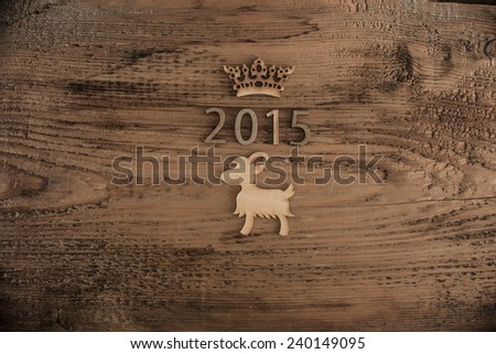 Sigh symbol from number 2015 crown on old retro vintage style wooden texture background Empty copy space for inscription Idea merry new year holiday year of Goat figure - stock photo