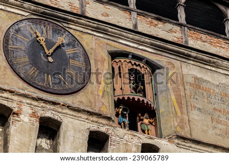 Sighisoara is a popular tourist destination for its well-preserved walled old town. The landmark of the city is the Clock Tower, a 64 m-high tower built in the 13th century. - stock photo