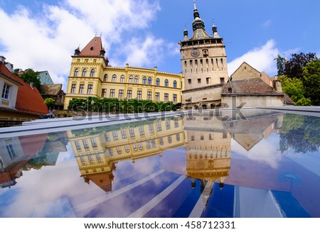 Sighisoara. Old Clock Tower reflection. Transylvania top tourist destination in Romania. Oldest medieval inhabited walled city in Europe. - stock photo