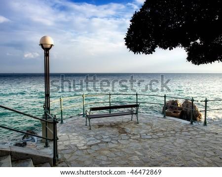 Sight on the Adriatic Sea from coastline of Opatija, a tourist town in Croatia. - stock photo
