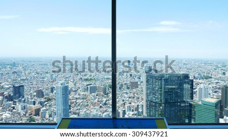 Sight seeing Japan from tall building window - stock photo