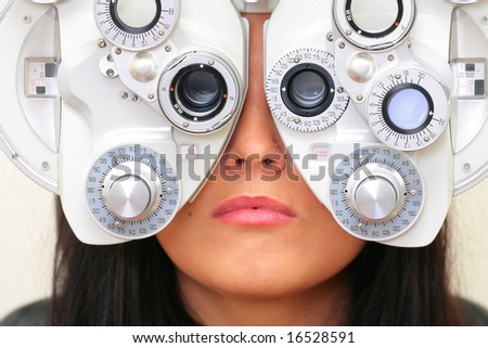sight testing at the optician - stock photo