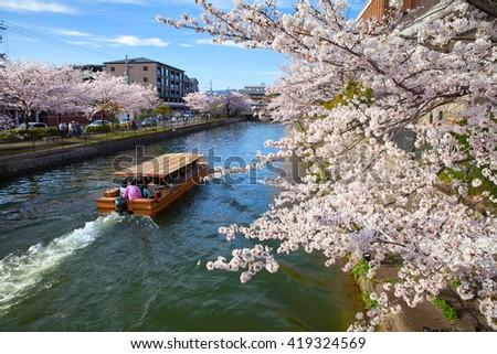 Sightseeing boat along biwa river, Kyoto, Japan - stock photo