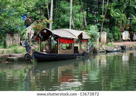 sightseeing boat at alppuza backwaters, kerala, india - stock photo