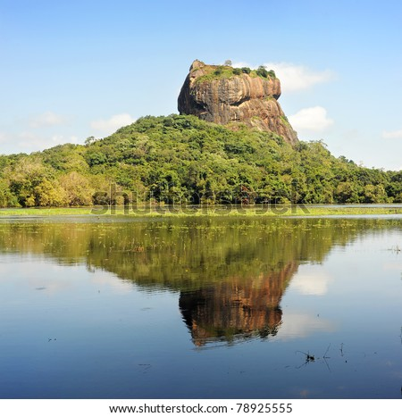 Sigiriya (Lion's rock) is an ancient rock fortress and palace ruin of Sri Lanka, surrounded by the remains of an extensive network of gardens, reservoirs, and other structures - stock photo