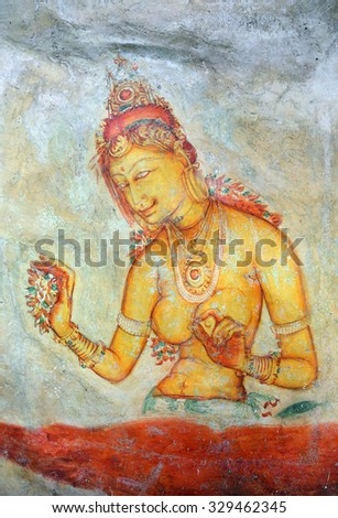 SIGIRIYA, SRI LANKA - MARCH 20, 2015: Sigiriya maiden - 5th century frescoes at the ancient rock fortress of Sigiriya in Sri Lanka - stock photo