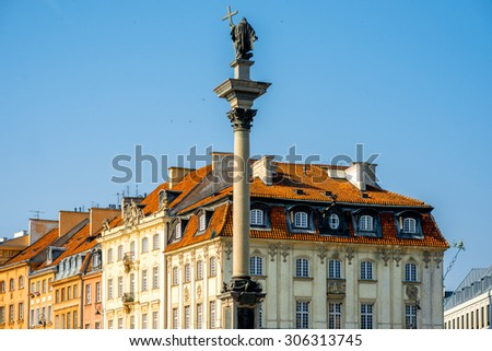 Sigismund's column with old buidings on the background on the castle square in Warsaw, Poland