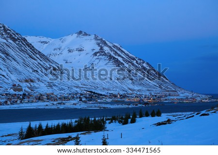 Siglufjordur at dusk in winter.