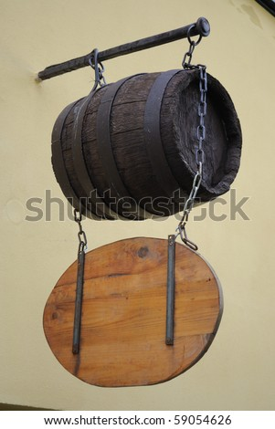 Sign above a medieval pub. - stock photo