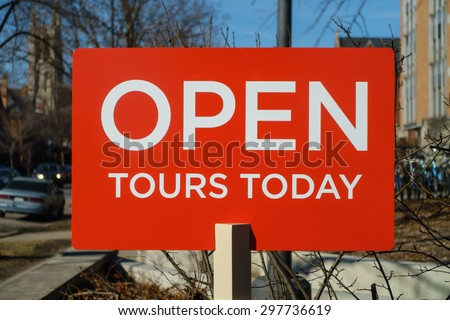 Sign advertising campus tours at the University of Chicago in the Hyde Park nieghborhood of Chicago, IL, USA. - stock photo