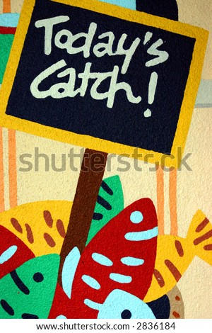 Sign advertising todays seafood catch - stock photo