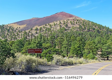 Sign and slope of the cinder cone at Sunset Crater Volcano National Monument north of Flagstaff, Arizona